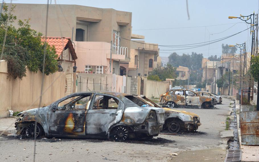 Residents of Mosul's al-Arabi neighborhood said Islamic State fighters forced them to burn their cars during a battle with Iraqi special forces troops on Jan. 20, 2017.