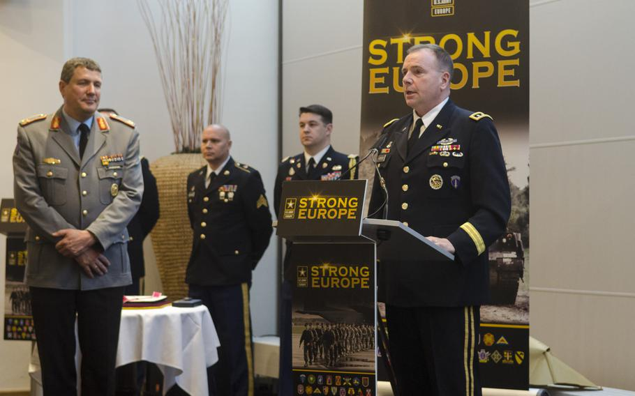 Lt. Gen. Ben Hodges, commanding general of U.S. Army Europe, speaks at a ceremony bidding farewell to the command's first German chief of staff, German Army Brig. Gen. Markus Laubenthal, left, Thursday, Jan. 26, 2017, at Clay Kaserne in Wiesbaden, Germany.