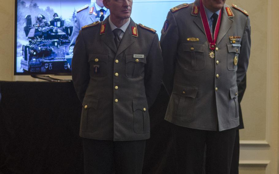 German Army Brig. Gens. Kai Rohrschneider, left, and Markus Laubenthal, stand during a ceremony welcoming Rohrschneider as the new U.S. Army Europe chief of staff and bidding farewell to Laubenthal, the first German to serve in that capacity.