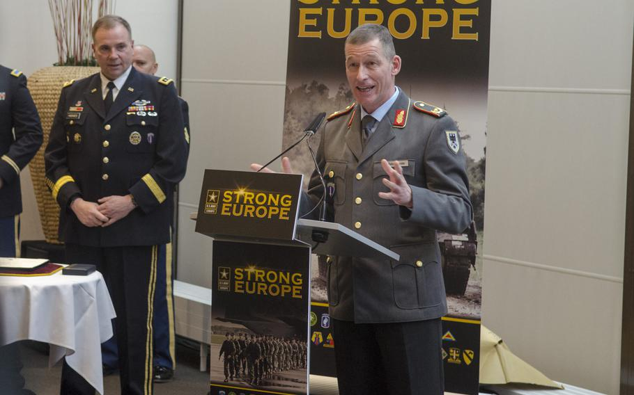 German Army Brig. Gen. Kai Rohrschneider, right, speaks during a ceremony welcoming him as the new U.S. Army Europe chief of staff, Thursday, Jan. 26, 2017, at Clay Kaserne in Wiesbaden. Rohrschneider, will be the second German to serve in that role, succeeding Brig. Gen. Markus Laubenthal.