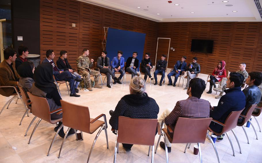 U.S. Army Lt. Philip Tappan of the U.S. Forces Afghanistan Band leads a talk on how to make a living as a musician. The lecture was part of a three-day conference with music students and instructors from Kabul University at the U.S. Embassy, Wednesday, Jan. 25, 2017.