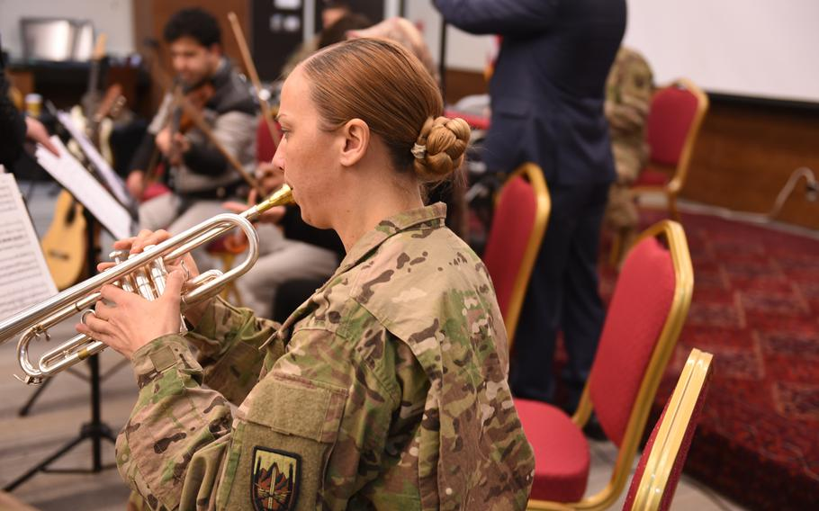 Sgt. Kendell Rivera of the U.S. Forces Afghanistan Band rehearses for a joint concert with students and instructors from Kabul University's music program at the U.S. Embassy in Kabul, Wednesday, Jan. 25, 2017.