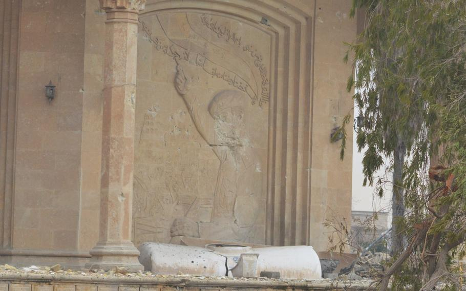 Saddam Hussein's face was erased by Islamic State militants at a palace overlooking the Tigris River in Mosul, Iraq.
