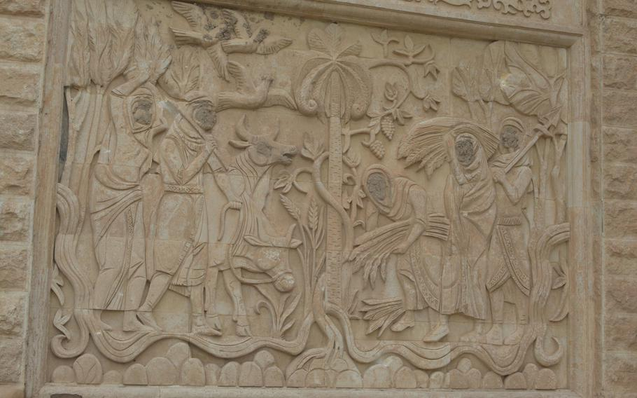The Islamic State group eradicated the faces from this frieze on a palace in Mosul, Iraq, that once served as the headquarters for Gen. David Petraeus.