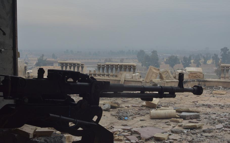 A machine gun points toward the Tigris River from a palace in Mosul, Iraq, on Wednesday, Jan. 25, 2017.