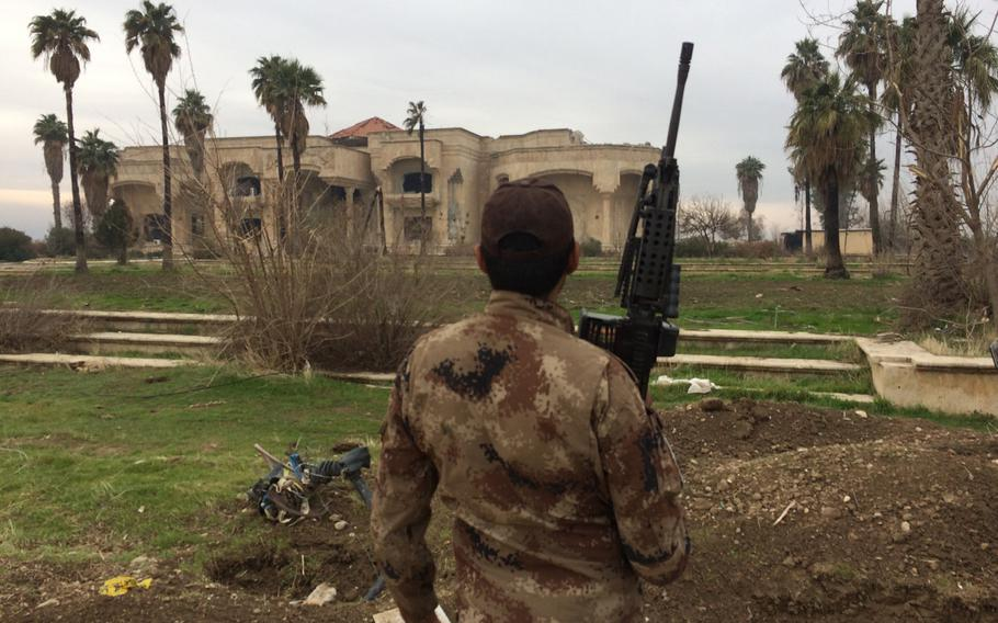 An Iraqi soldier stands guard at a palace in Mosul, Iraq, on Wednesdsay, Jan. 25, 2017.