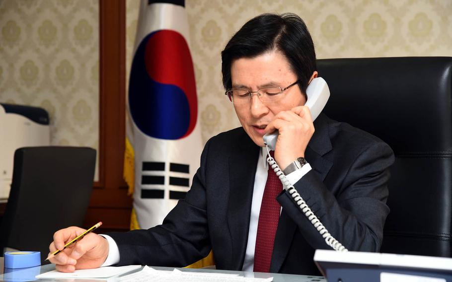 South Korea's acting President Hwang Kyo-ahn speaks to President Donald Trump, Monday, Jan. 30, 2017.
