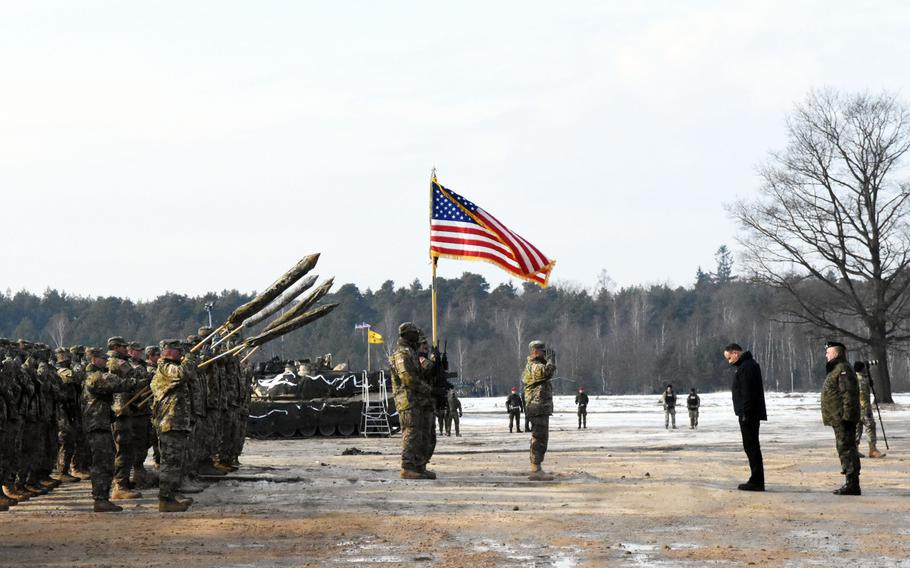 Poland's President Andrzej Duda pays his respects to the U.S. Army during the live fire exercise between the two nations, on Monday, Jan. 30, 2017.