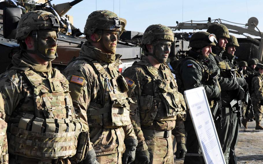 American and Polish soldiers in front of their vehicles at the live fire exercise in Zagan, Poland, on Monday, Jan. 30, 2017.