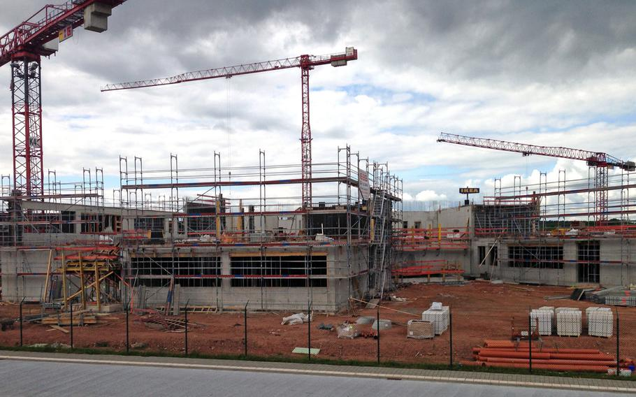 Construction crews work on the new Kaiserslautern High School in May 2016. Germany helps pay for part of the construction costs for new schools in Germany. President Donald Trump has made allied burden sharing an issue for his administration.