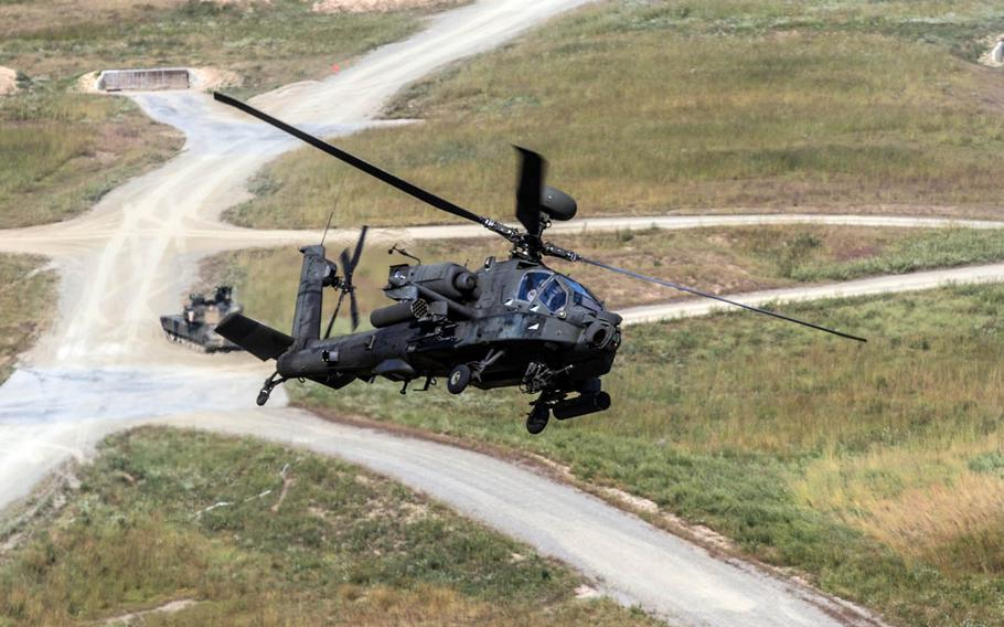 An AH-64 Apache provides attack support to ground forces at South Korea's Rodriguez live-fire training complex in 2015.