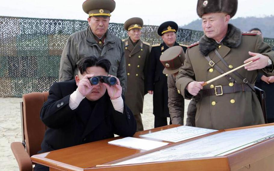 North Korean leader Kim Jong Un sits surrounded by officials in this undated photo from the state-run Korean Central News Agency.