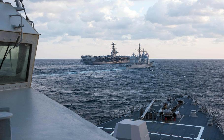The guided-missile cruiser USS Mobile Bay and guided-missile destroyer USS Stockdale steam in formation with the USS John C. Stennis aircraft carrier off the Korean peninsula during Foal Eagle 2016.