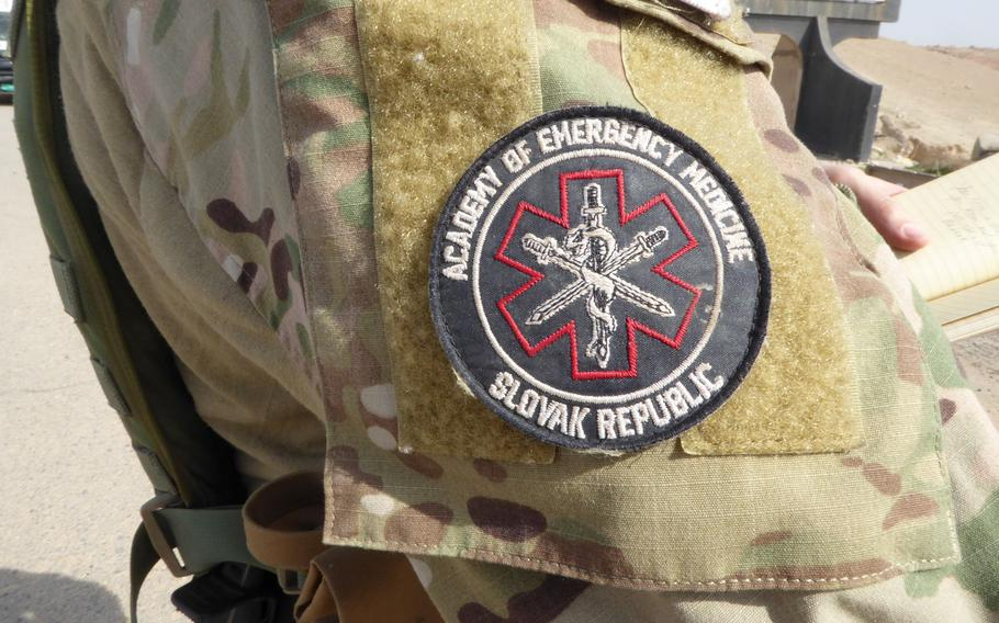 A volunteer medic near the front lines of the battle for Mosul, Iraq, wears the patch of the Slovak charity Academy of Emergency Medicine on Tuesday, Feb. 28, 2017. Medics, including several military veterans from the United States and Europe, are working with the charity to treat casualties in an area where medical services are limited.