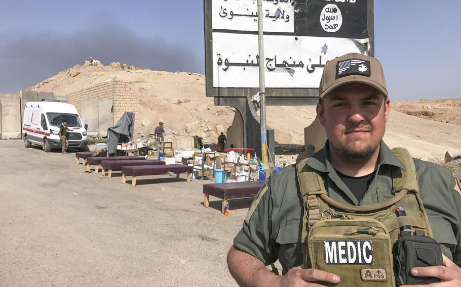 U.S. Marine Corps veteran Chris Lint, of Santa Cruz, Calif., is pictured here on Tuesday, Feb. 28, 2016, at a roadside medic station near the Wadi Hajar neighborhood of Mosul. Lint is one of more than a dozen medics working with a Slovak nonprofit to treat wounded Iraqis on the front line of the Mosul battle.