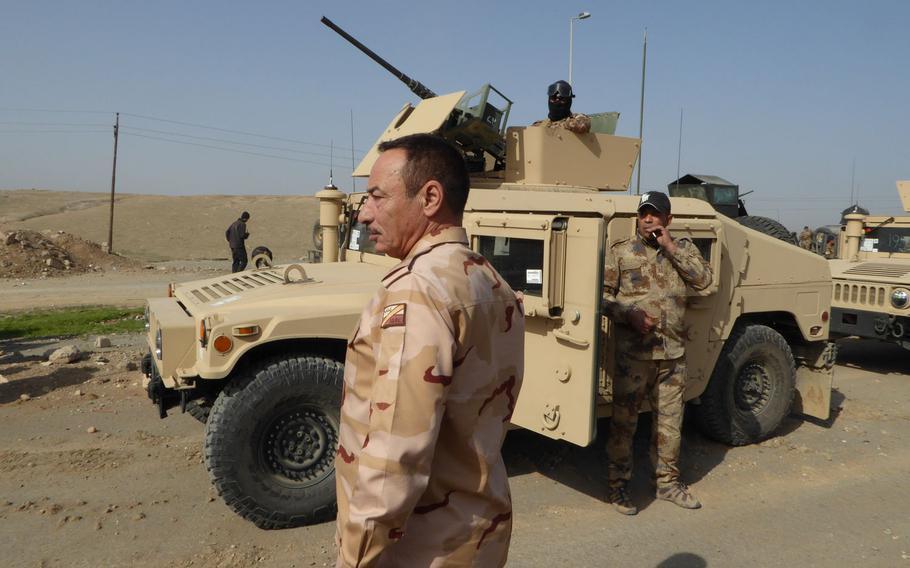 Commander of Nineveh Operations, Maj. Gen. Najim al Jabouri, visits an area where the Iraqi army's Counter Terrorism Service was preparing to advance on Mosul's Wadi Hajar neighborhood, Tuesday, Feb. 28, 2017.