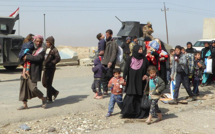 Pictured here are some of the roughly 100 Iraqi civilians who fled Mosul on the Mosul-Baghdad Highway on Tuesday, Feb. 28, 2017, after Iraqi army Counter Terrorism Service troops opened the road and began an attempt to advance on the Mosul neighborhood of Wadi Hajar.