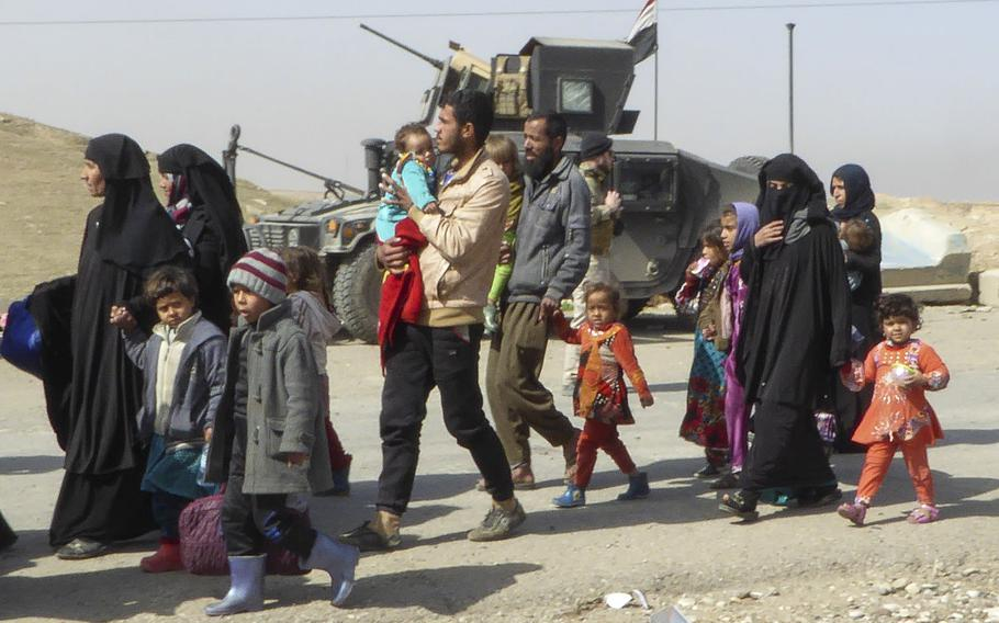 Pictured here are some of the roughly 100 Iraqi civilians who fled Mosul on the Mosul-Baghdad Highway on Tuesday, Feb. 28, 2017, as Iraqi troops prepared to advance on the Mosul neighborhood of Wadi Hajar. About 10,000 civilians have been displaced since fighting began in western Mosul on Feb. 19, in addition to more than 200,000 displaced when the offensive began in eastern Mosul on Oct. 17, 2016.