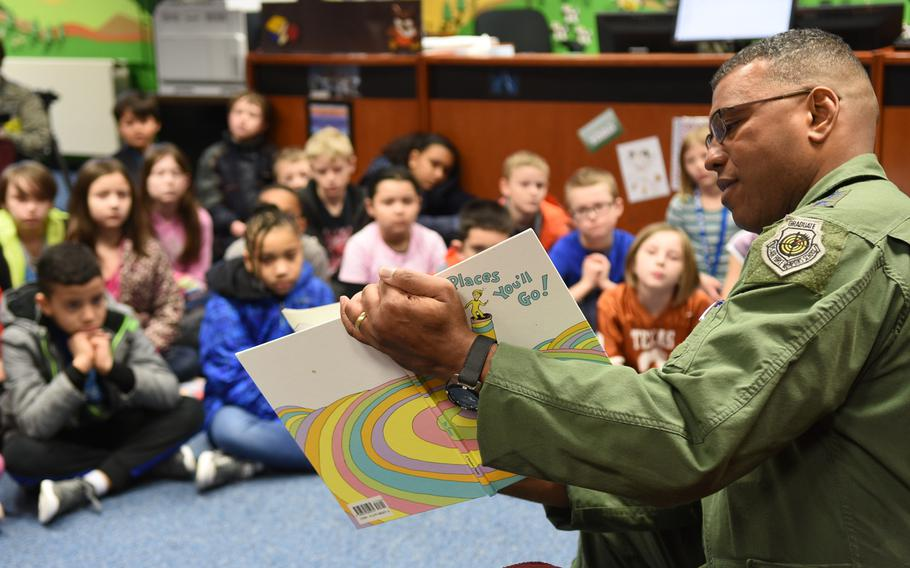 """Lt. Gen. Richard Clark, 3rd Air Force commander, reads Dr. Seuss' """"Oh, the Places You'll Go"""" to students at Ramstein Intermediate School in Germany on Thursday, March 2, 2017."""