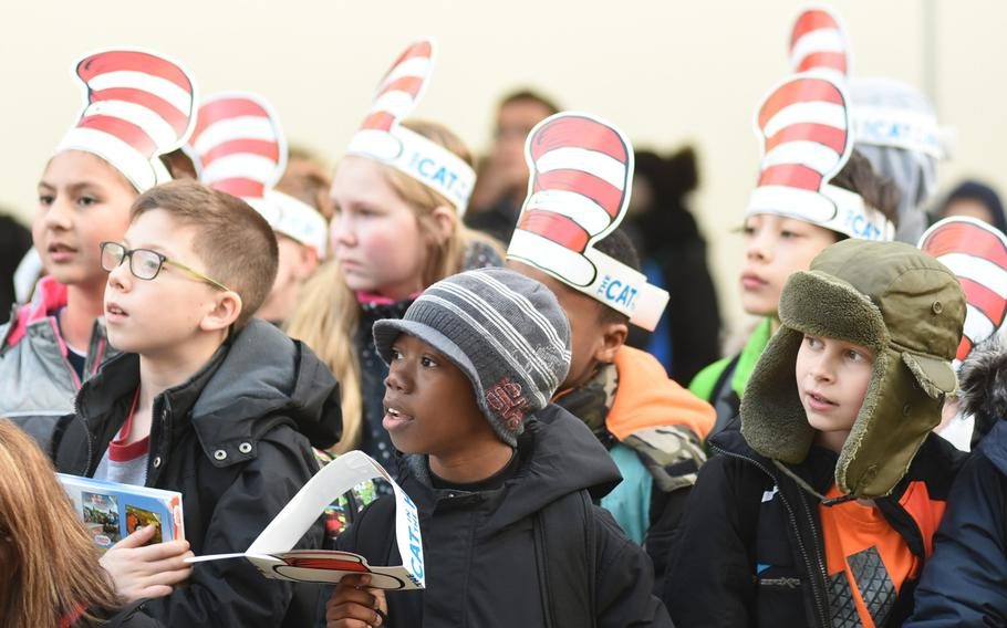 """Students at Ramstein Intermediate School in Germany celebrate Dr. Seuss' birthday by wearing paper """"The Cat in the Hat"""" hats on Thursday, March 2, 2017."""
