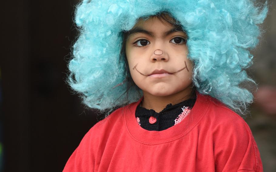 """Gabriella Alcorta, a third-grader at Ramstein Intermediate School in Germany, dressed up as Thing Two, a character from Dr. Seuss' famous children's book """"The Cat in the Hat."""" The school celebrated Dr. Seuss' birthday on Thursday, March 2, 2017, as part of the national Read Across America Day."""