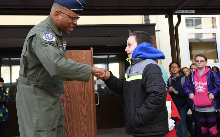 Lt. Gen. Richard Clark shakes hands with Ramstein Intermediate School, Germany, fifth-grader Skylar Murray on Thursday, March 2, 2017. Clark slipped him a military coin for being one of his school's most prolific readers.
