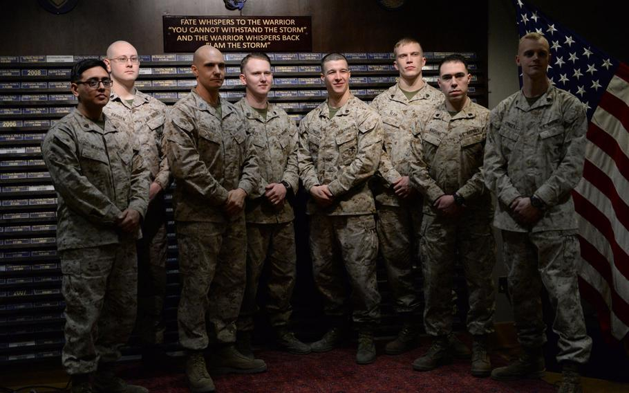 Members of the Marine Security Guard detachment in Kabul, Afghanistan, stand in front of a memorial to other Marines and Navy corpsmen who have died in Afghanistan since 2001, Thursday, March 2, 2017. From left, Sgt. Nelson Moreno, Sgt. Bryan Barden, Gunnery Sgt. Christopher Tari, Sgt. Layton Nobles, Sgt. Zachary Phillips, Sgt. Joel Ream, Sgt. Owen Nardini and Sgt. Christopher Vincent.
