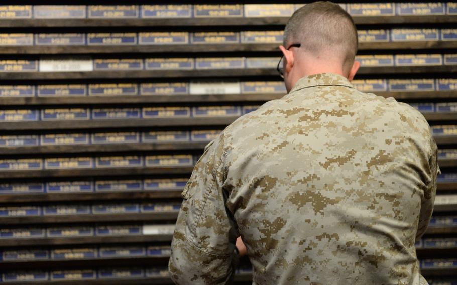 A Marine reflects at a new memorial to Marines and Navy corpsmen killed in Afghanistan at the U.S. Embassy in Kabul on Thursday, March 2, 2017.