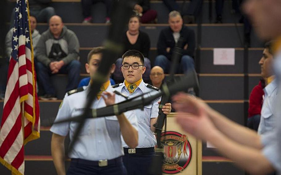SHAPE's drill team competes in the armed team rifle exhibition during the DODEA-Europe JROTC drill team championships in Kaiserslautern, Germany, on Saturday, March 4, 2017. SHAPE won the event.