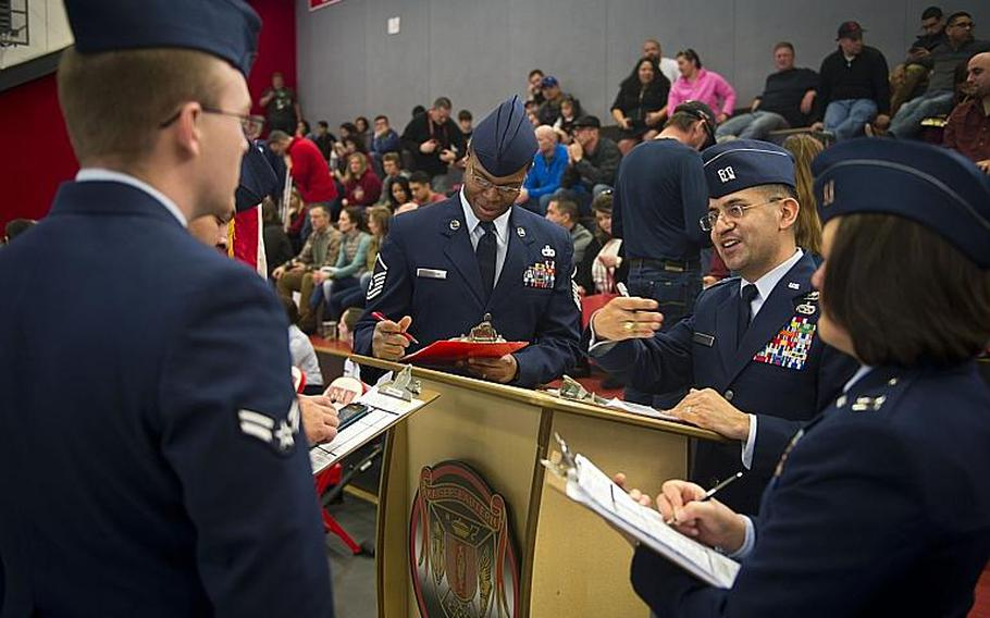 Airmen compare scores after judging a drill event during the DODEA-Europe JROTC drill team championships in Kaiserslautern, Germany, on Saturday, March 4, 2017.