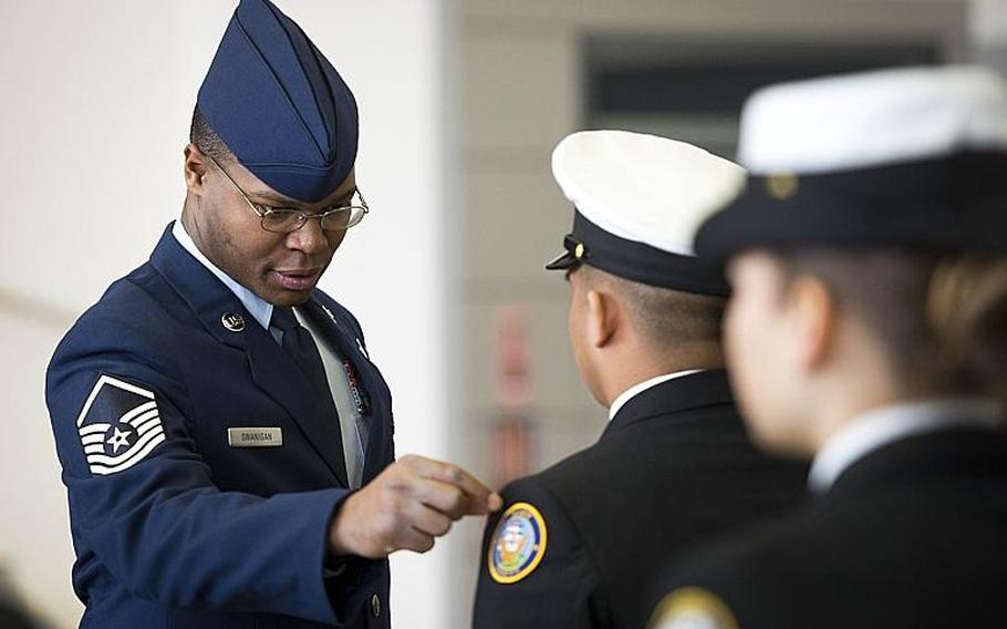 Master Sgt. Ryan Swanigan, left, inspects a cadet from the Sigonella drill team during the inspection portion of the DODEA-Europe JROTC drill team championships in Kaiserslautern, Germany, on Saturday, March 4, 2017. Swanigan is from the 721st Aerial Port Squadron at Ramstein Air Base.