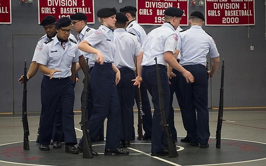 Members of the Kaiserslautern drill team compete in the armed team rifle exhibition during the DODEA-Europe JROTC drill team championships in Kaiserslautern, Germany, on Saturday, March 4, 2017.