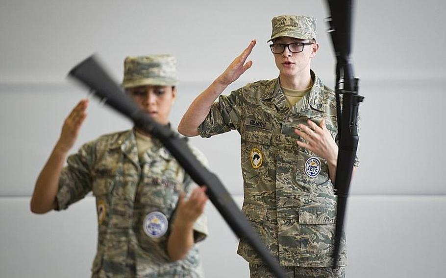 Alconbury's Tyler Gilhuys, right, and Victoria Flores perform in the armed dual rifle exhibition during the DODEA-Europe JROTC drill team championships in Kaiserslautern, Germany, on Saturday, March 4, 2017.