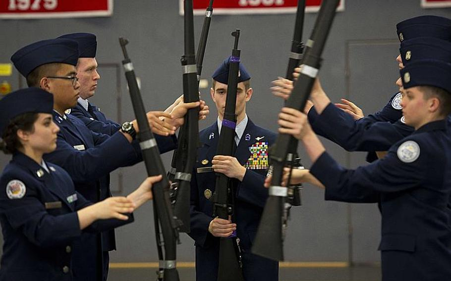 Members of Bitburg's drill team compete in the armed team rifle exhibition during the DODEA-Europe JROTC drill team championships in Kaiserslautern, Germany, on Saturday, March 4, 2017.