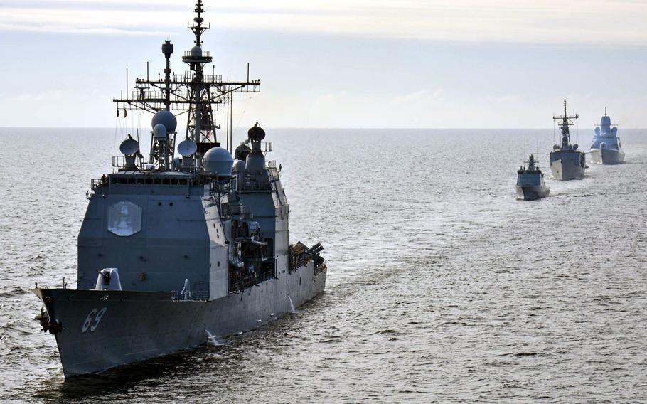From left, Standing NATO Maritime Group 2 ships USS Vicksburg , Lithuanian frigate LNS Aukstaitis, Turkish ship TCG Goksu and  Dutch ship HNLMS Tromp participate in ship maneuvering drills during a passing exercise in the Baltic Sea in 2015.