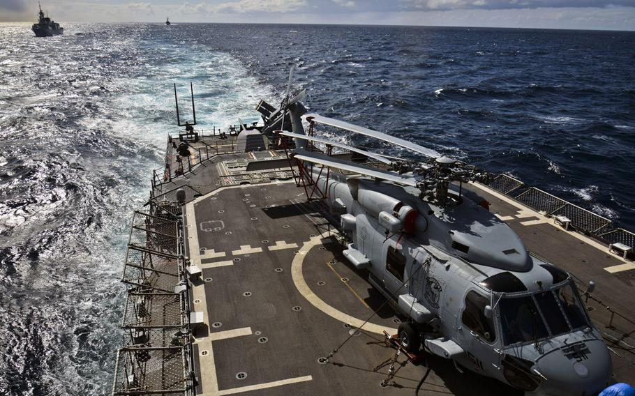 An MH-60R Seahawk helicopter, embarked aboard Standing NATO Maritime Group 2 flagship USS Vicksburg, sits on the ship's flight deck during an underway replenishment in the Atlantic Ocean in April 2015.