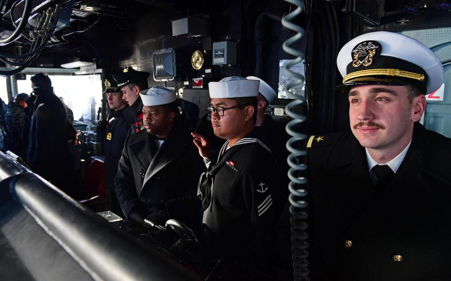 Sailors aboard the guided-missile cruiser USS Hue City  as the ship arrives in Tallinn, Estonia, Wednesday, Feb. 22, 2017. Hue City arrived in Tallinn for a scheduled port visit to enhance U.S.-Estonia relations.