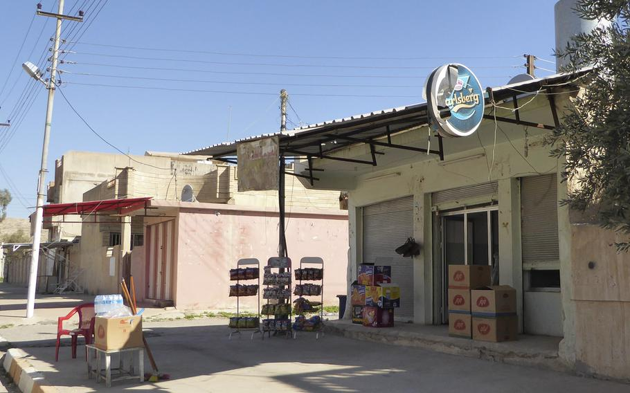 Khiri Elias sells alcohol from a small shop in Bashiqa, Iraq, pictured here on Monday, March 6, 2017.