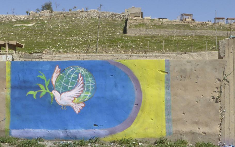 A recently painted mural of a dove on a wall in Bashiqa, Iraq, Monday, March 6, 2017. The village was liberated from the Islamic State group in November. Before the militants swept in, the village was considered one of the country's more peaceful areas.