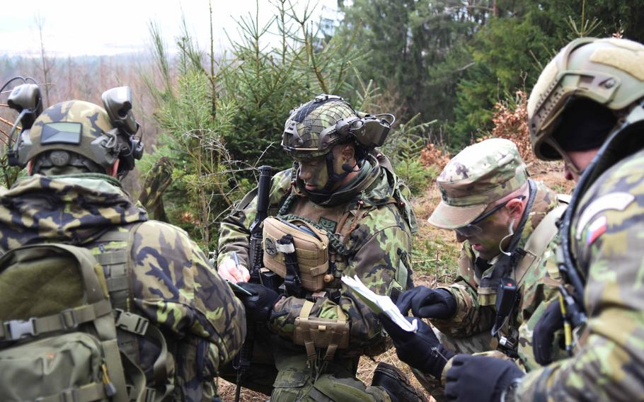 U.S. and Czech soldiers coordinate artillery fire during Operation Dynamic Front on Wednesday, March 8, 2017.