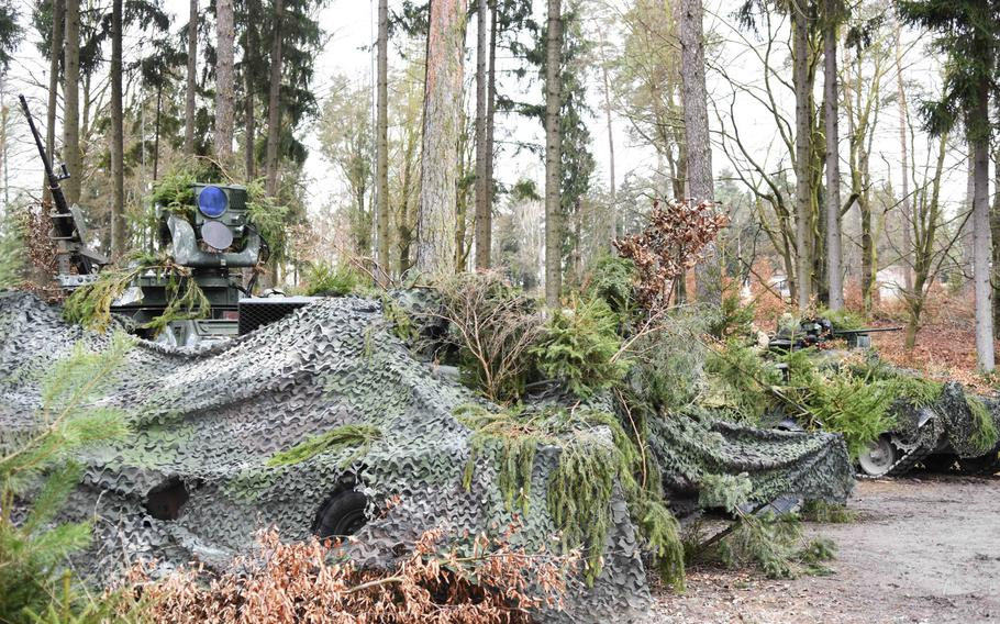 Various camouflaged artillery observation vehicles from participating NATO nations during Exercise Dynamic Front on Wednesday, March 8, 2017.