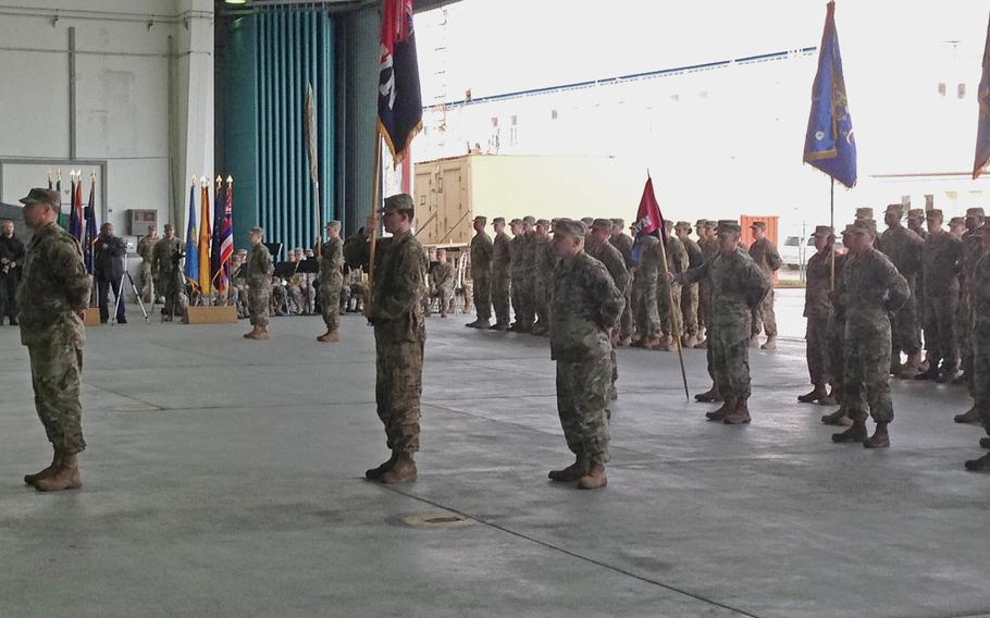 Commanders and soldiers of the 10th Combat Aviation Brigade uncase their unit colors, symbolizing their arrival in Europe, in a ceremony at Storck Barracks in Illesheim, Germany, Thursday, March 9, 2017. The 10th CAB, of Fort Drum, N.Y., is the Army's first rotational aviation brigade in Europe.