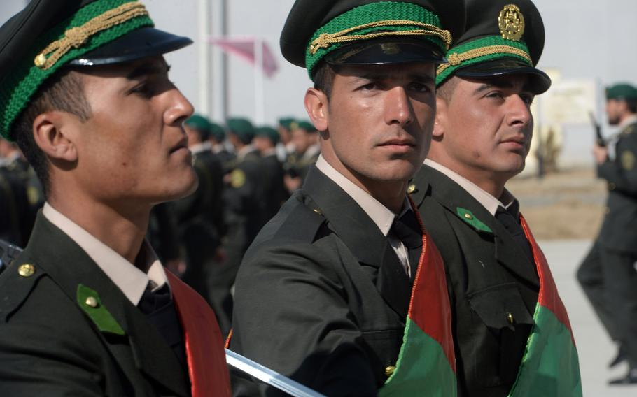 Afghan army soldiers participate in a march near Camp Qargah in the western outskirts of Kabul to mark the induction of 340 new officers on Thursday, March 9, 2017.