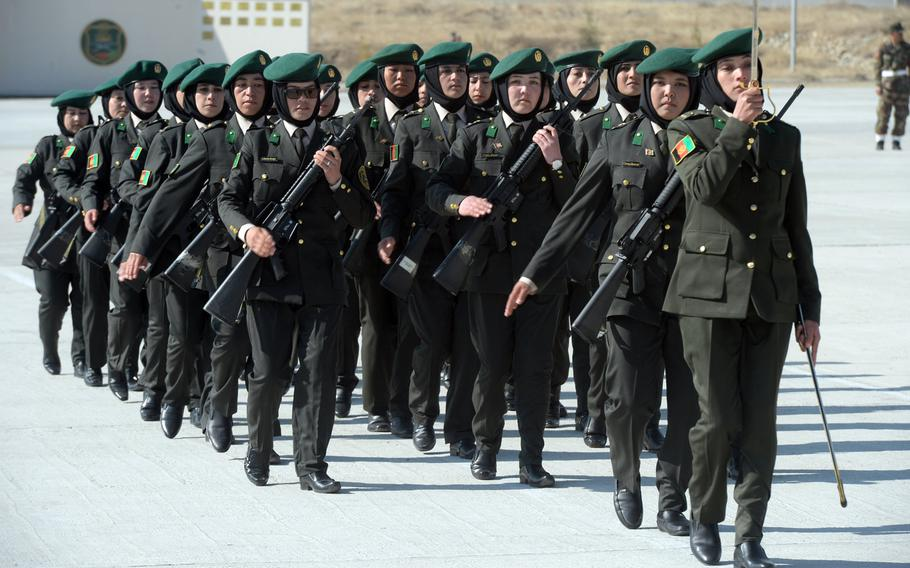 Afghan cadets march at a training area near Camp Qargah on Thursday, March 9, 2017, before graduating to become Afghan army officers.