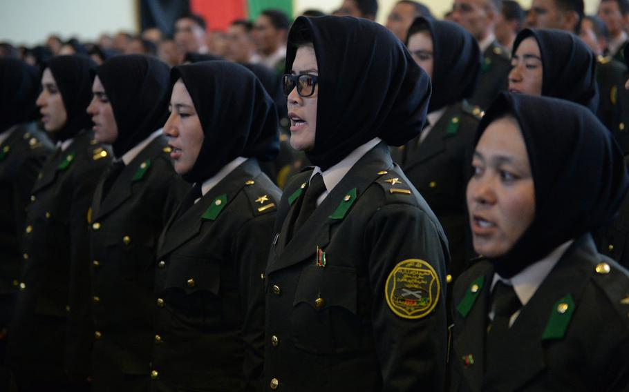 Second Lt. Hamida Haidery, second from right, attends a graduation ceremony near Camp Qargah, where she and 21 other females became officers in the Afghan army, Thursday, March 9, 2017,
