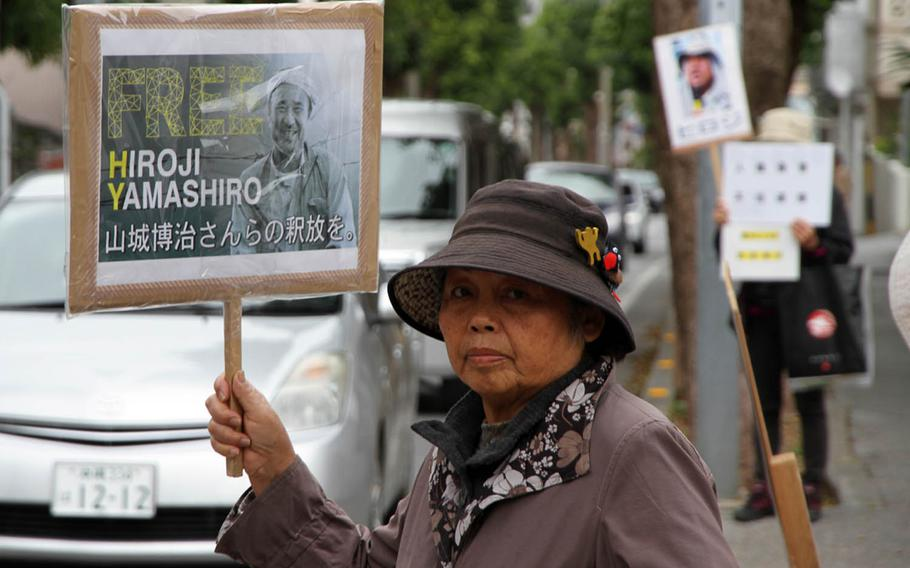 Demonstrators call for the release of Okinawan anti-U.S. base protest leader Hiroji Yamashiro in front of Naha District Court Friday, March 3, 2017.