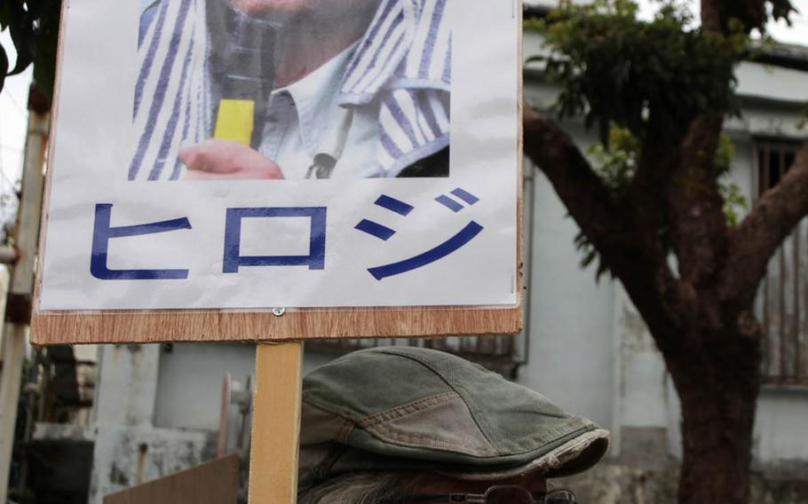 People gather daily in front of Naha District Court in Okinawa, Japan, to protest the detention of anti-U.S. base protest leader Hiroji Yamashiro, who has been held in solitary confinement without bail since October.