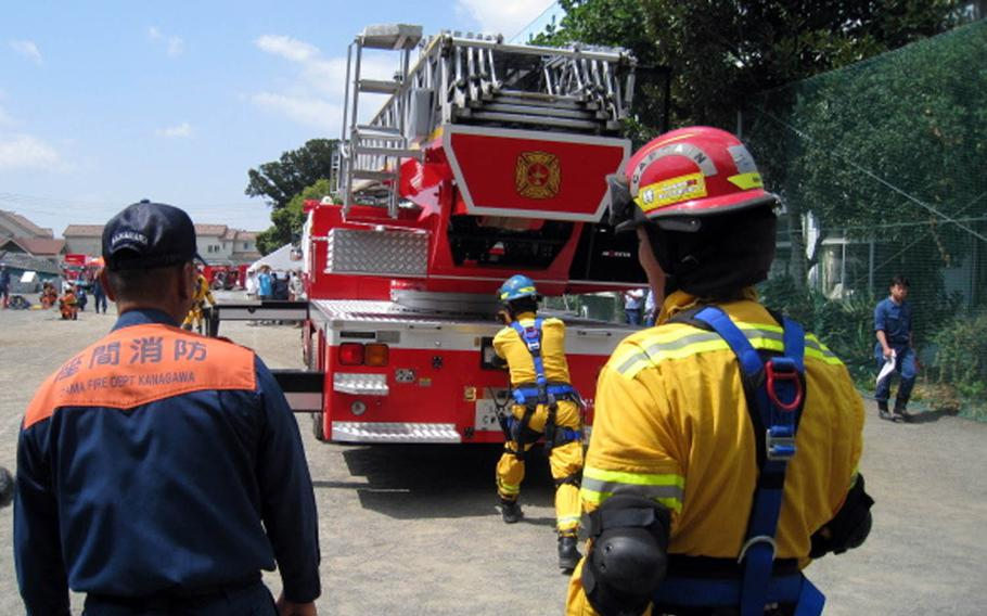 Camp Zama firefighters work with a Japanese unit from Zama City during disaster-response training in 2013.