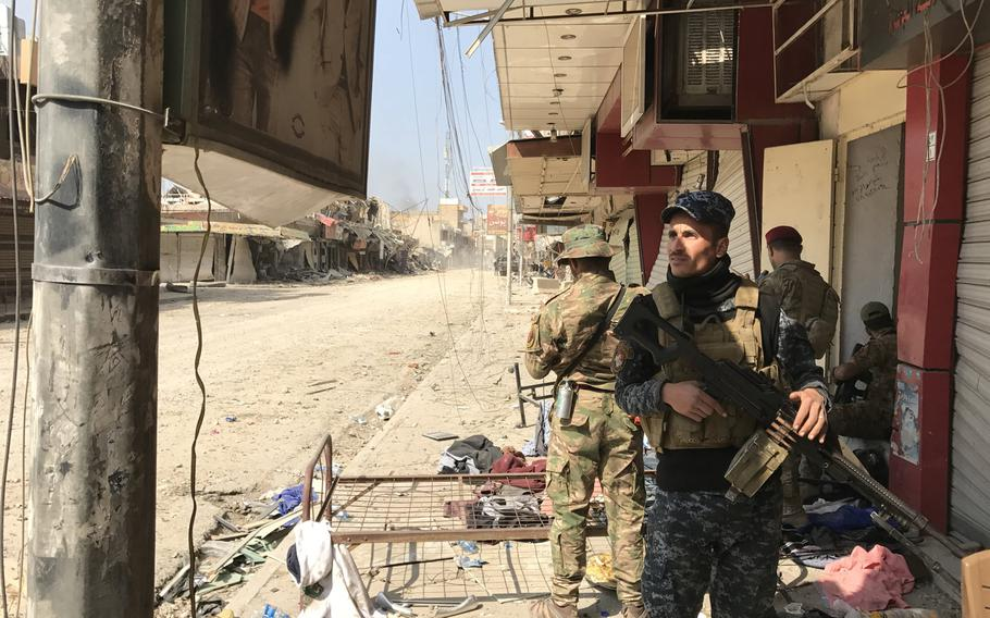 An Iraqi federal police officer stands watch on a street in central Mosul on Wednesday, March 8, 2017. The police and a special operations unit called the emergency response division were working to clear western Mosul neighborhoods close to the Tigris River, while other Iraqi forces were fighting Islamic State farther to the west.