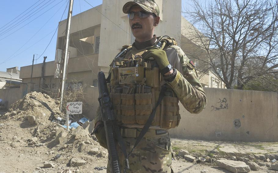 An Iraqi emergency response division soldier stands guard near a medical field clinic in western Mosul on Thursday, March 9, 2017.